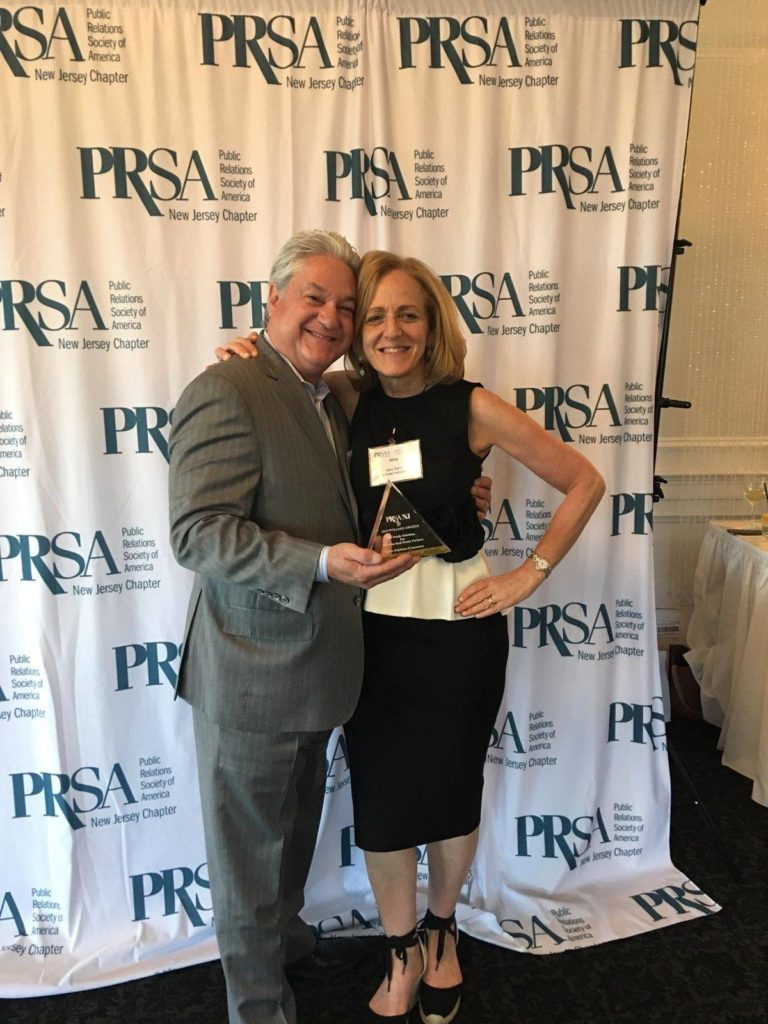 "alt=""Amy Stern and Dave Scelba holding PRSA Pyramid Award"""